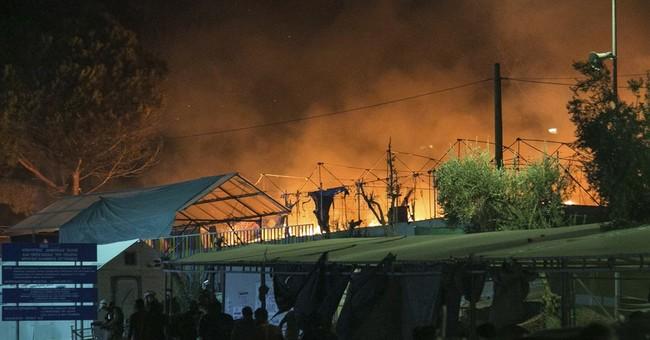 EU: Migrants to stay on Greek islands despite fire