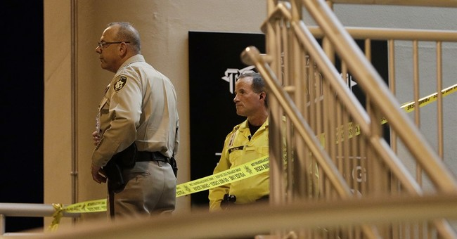 2 wounded, man held after Las Vegas airport lot shooting