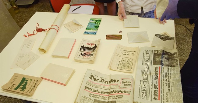 Nazi-era coins, photos, Hitler's book found in Poland