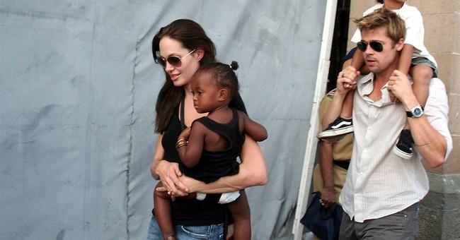 The Latest: Pitt 'saddened,' asks press to leave kids alone