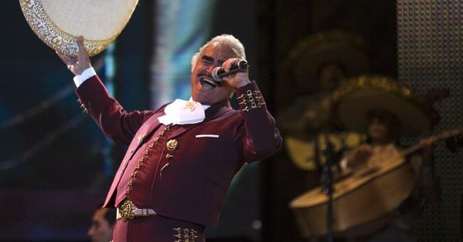 Mexico's 'King of Ranchera' records ballad backing Clinton