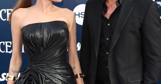 Jolie and Pitt's romance, divorce bookended by films