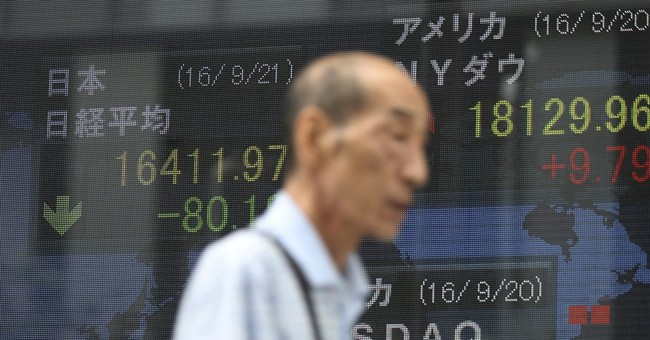 Stocks rise after Bank of Japan move, ahead of Fed
