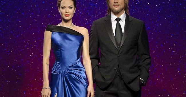 Madame Tussauds separates wax figures of Pitt, Jolie