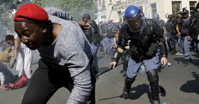 South African police battle stone-throwing students