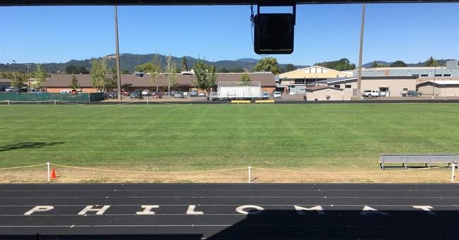Small town laments loss of football season due to hazing