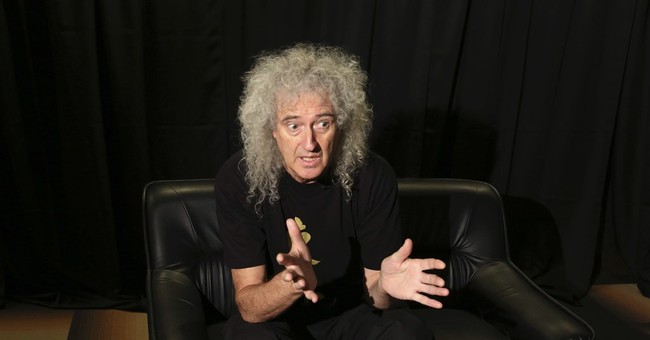 Queen guitarist Brian May protests Japanese dolphin hunts