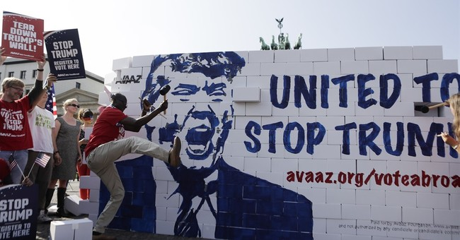 Activists in Germany rally against Donald Trump
