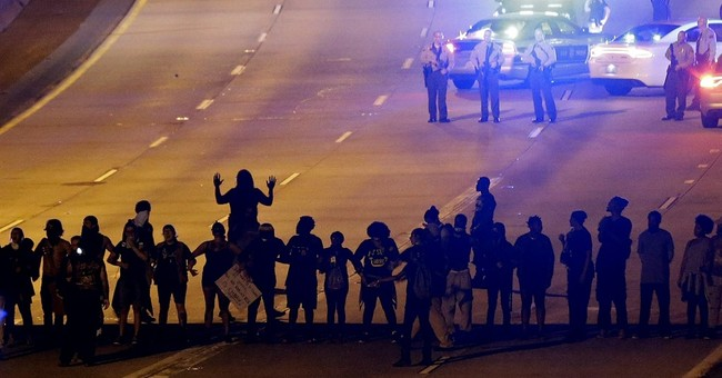 The Latest: Police don't plan to remove peaceful protesters