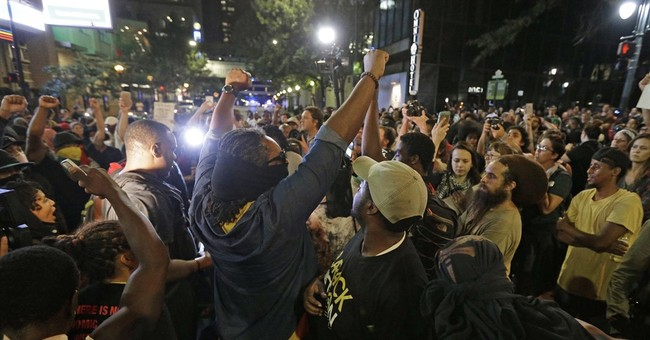 The Latest: Demonstrators stay out past Charlotte curfew