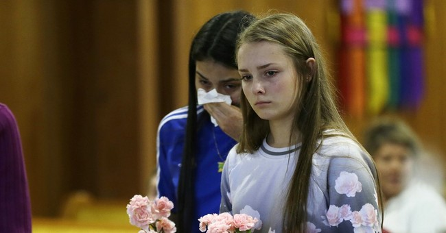 The Latest:  Documents: Mall shooting suspect confessed