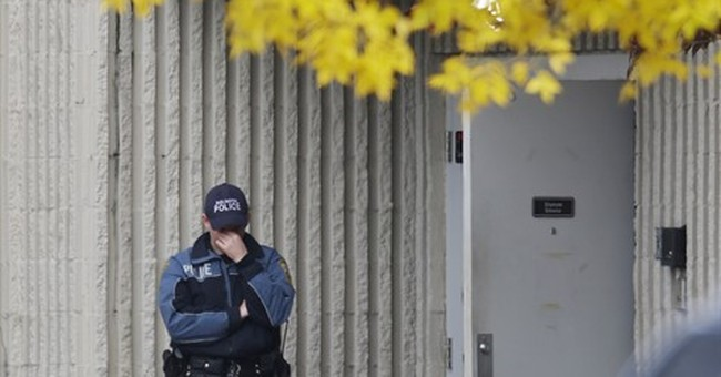 The Latest: Report: Suspect faces domestic-violence charges