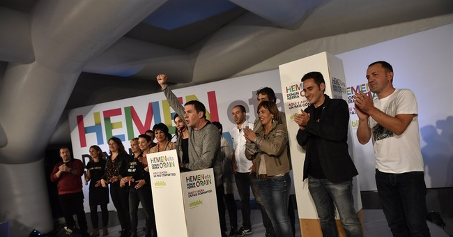 Spain's regional elections give boost to Rajoy's party