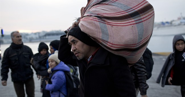 The Latest: Macedonia closes border to refugees