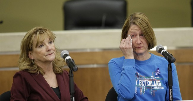 The Latest: Teacher says principal pushed students to safety