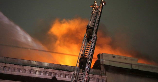 The Latest: Arson not suspected in Canal Street blaze