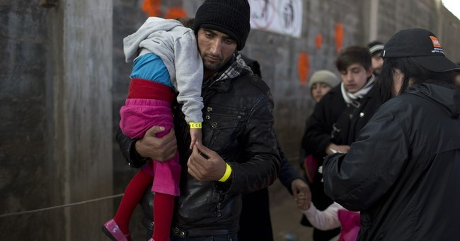 AP PHOTOS: Thousands brave the cold to cross sea to Greece