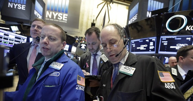Asian stocks edge higher after cautious Fed outlook