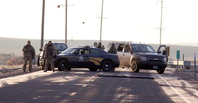 The Latest: Official: Man shot was reaching toward waistband