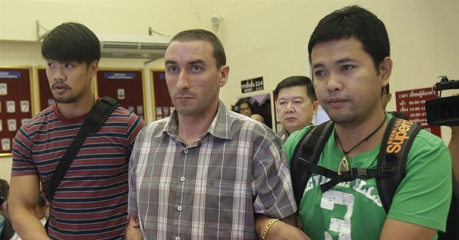 Thai police seek ID on dismembered body found in freezer