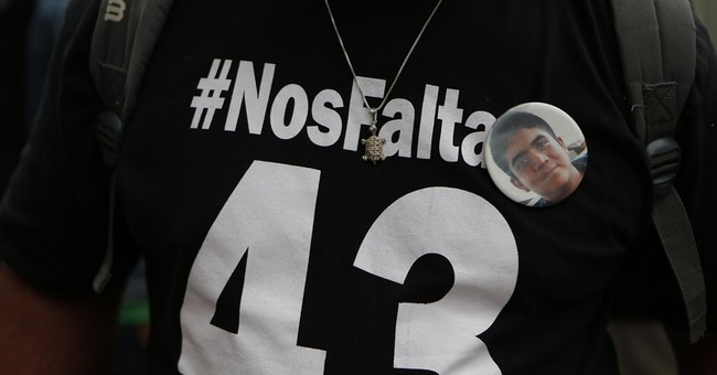 Families of missing 43 students lead march in Mexico