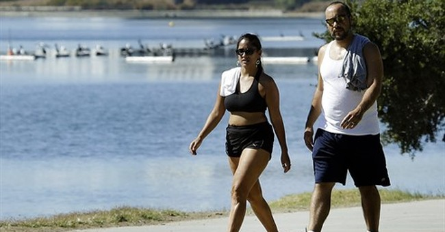 The Latest: California bakes in high heat