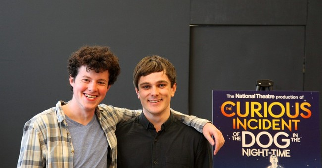 A torch is passed at national tour of 'The Curious Incident'