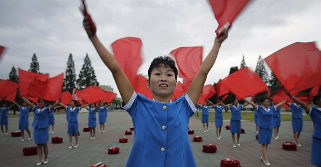 AP Photos: Pyongyang starts day early with patriotic music