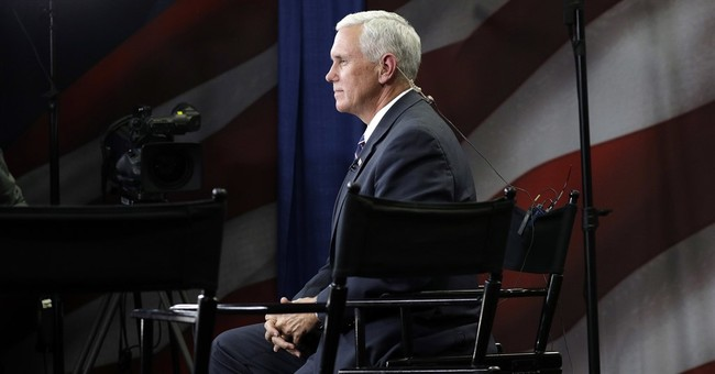Pence breaks with Trump, says humans affect climate change