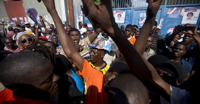 Former President Aristide leaps from behind scenes in Haiti