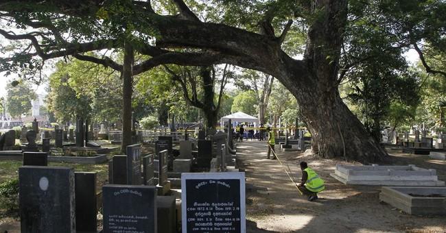 Sri Lanka exhumes body of slain editor for new investigation