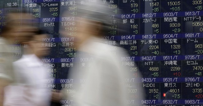 Asian stocks mixed as traders follow US debate