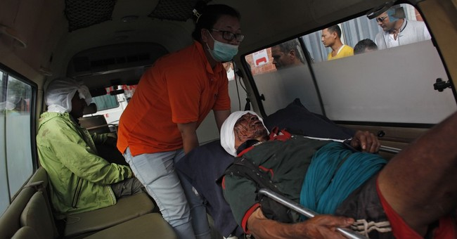 Overcrowded bus slips off mountain road in Nepal, killing 18