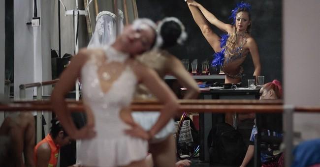 AP PHOTOS: Pole dancers face tough routine _ and prejudices