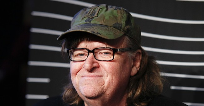 Filmmaker Michael Moore says theater won't allow his show