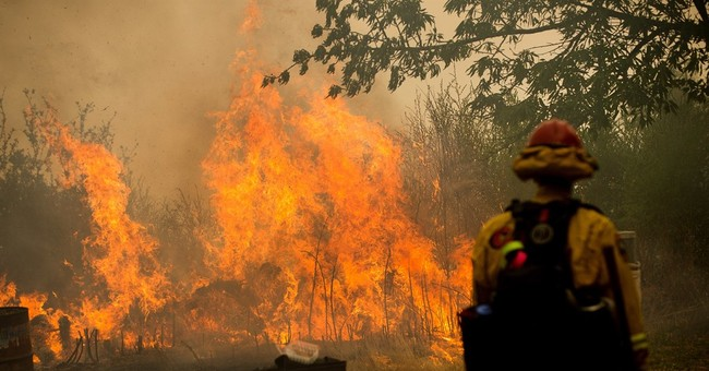 Growing California wildfire threatens remote mountain homes