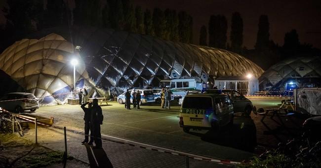 German police shoot dead man wielding knife in refugee home