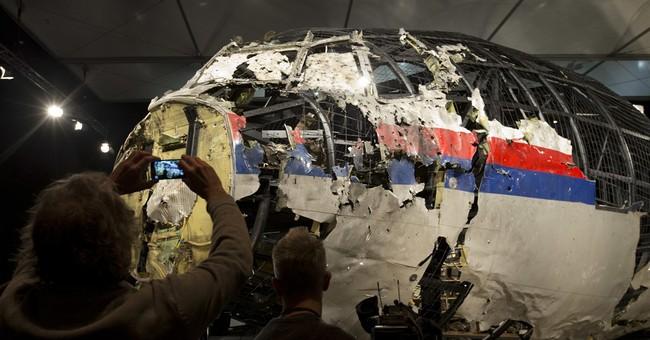 The Latest: UN secretary-general praises downed plane probe