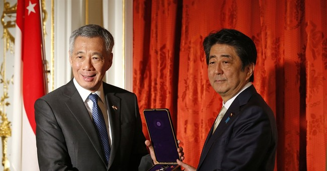 Japan PM promotes Shinkansen 'bullet' train to Singapore
