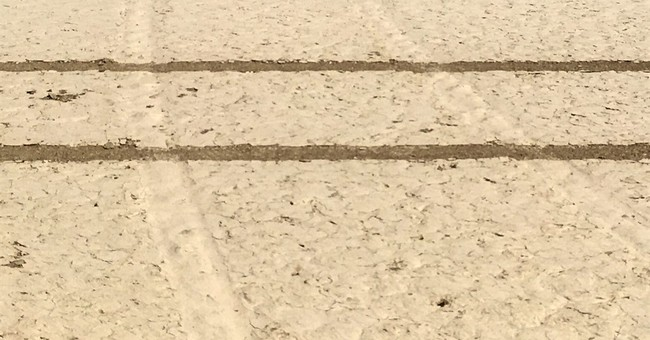 Driver defaces Death Valley landmark with tire tracks