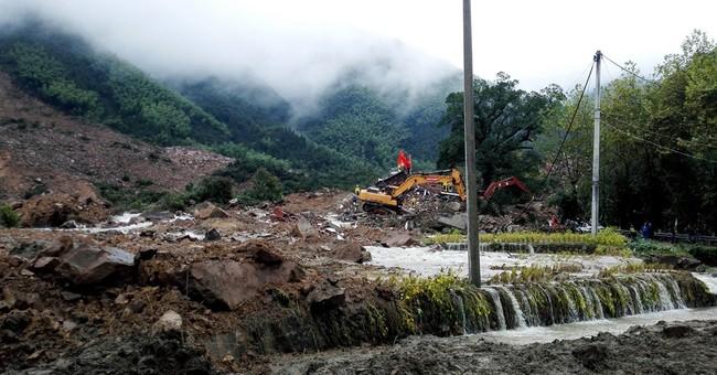 13 dead, 20 still missing in China after typhoon landslides