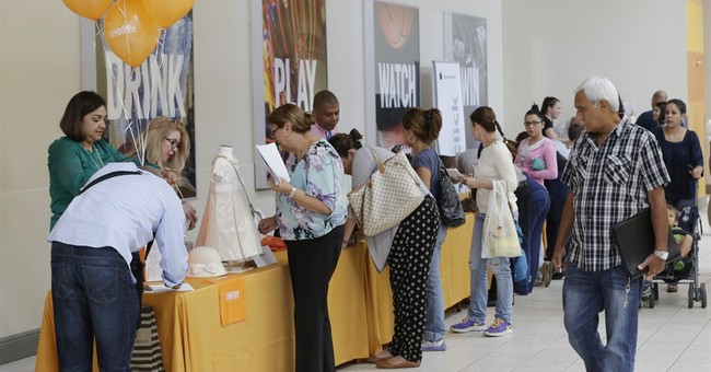 Applications for US unemployment aid tick higher to 254,000