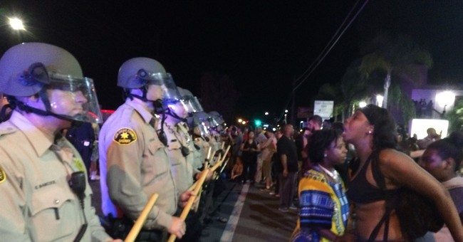The Latest: Fourth night of protests of police shooting