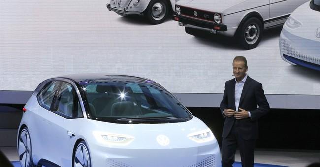Electrics touted at Paris car show, but await their moment