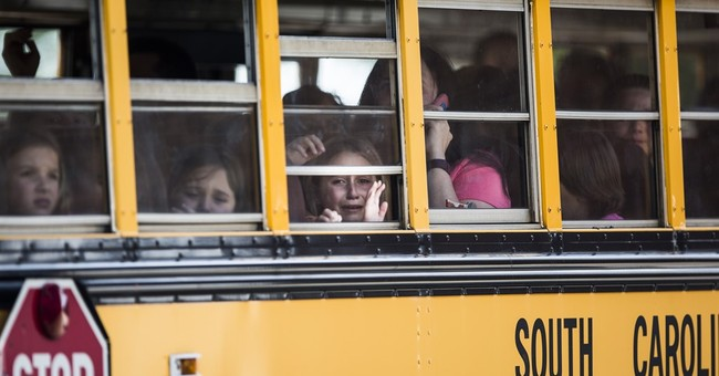 The Latest: Superintendent: Training saved students' lives