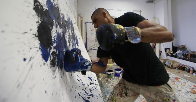 AP PHOTOS: Artist gets out his boxing gloves to create