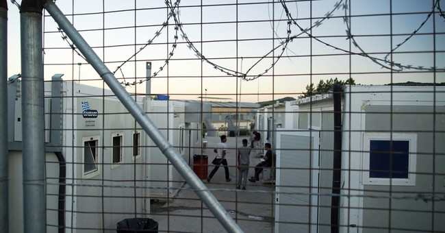 The Latest: Germany saw 820,000 asylum-seekers last year