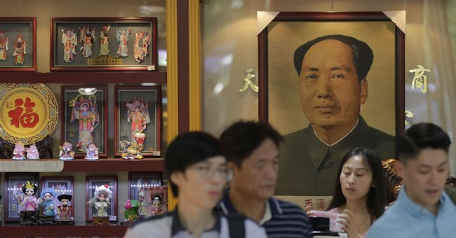Survey: Chinese factories eke out expansion in September