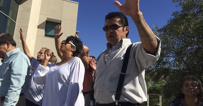 The Latest: Father of man killed by officer addresses rally