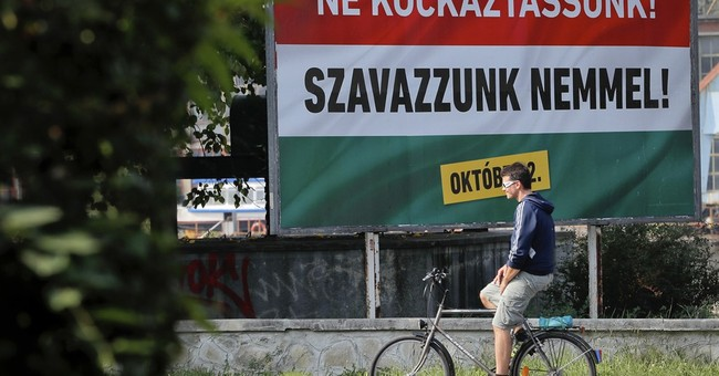 The Latest: EU leader sees danger in Hungary migrant vote